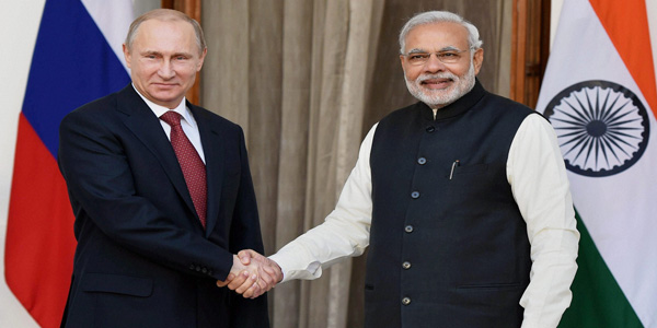 vladimir putin shaking hands with modi