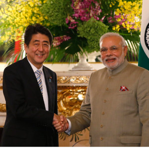 modi shaking hands with shinzo abe
